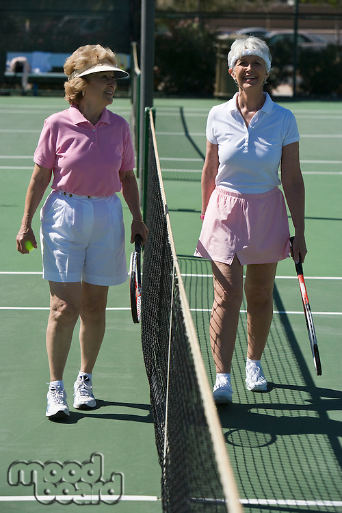 Two senior women on tennis court