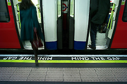 © Licensed to London News Pictures. 08/01/2013, London, UK. 'Mind The Gap' signs are seen marked on the platform at Belsize Park underground station in London, Tuesday, Jan. 8, 2013. London Underground mark its 150 year anniversary on 9 January. In 1863 January 9 the world first underground train entered into public service. Photo credit : Sang Tan/LNP