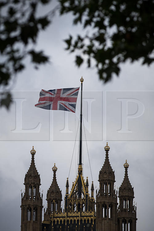 © Licensed to London News Pictures . 05/07/2016 . London , UK . The Union Jack flying upside down above Parliament today , Tuesday 5th July 2016 ) . Photo credit: Joel Goodman/LNP