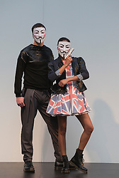 "© Licensed to London News Pictures. 21/04/2012. London, England. Models wearing ""V for Vendetta"" masks whilst modelling designs by Charlotte Haggerty and Brett Le Bratt on the closing day of Alternative Fashion Week at London's Spitalfields Market. Photo credit: Bettina Strenske/LNP"