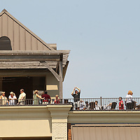 Residents gather on the roof top of Park Heights to watch the solar eclipse pass over.