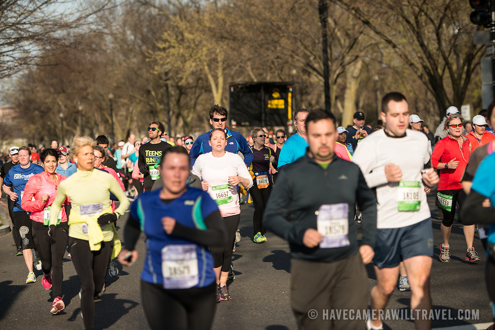 Runners in the 2013 Cherry Blossom 10-Mile Run. Scheduled to coincide with the National Cherry Blossom Festival in early spring, the race takes runners along the National Mall and by the famous cherry blossoms around the Tidal Basin.