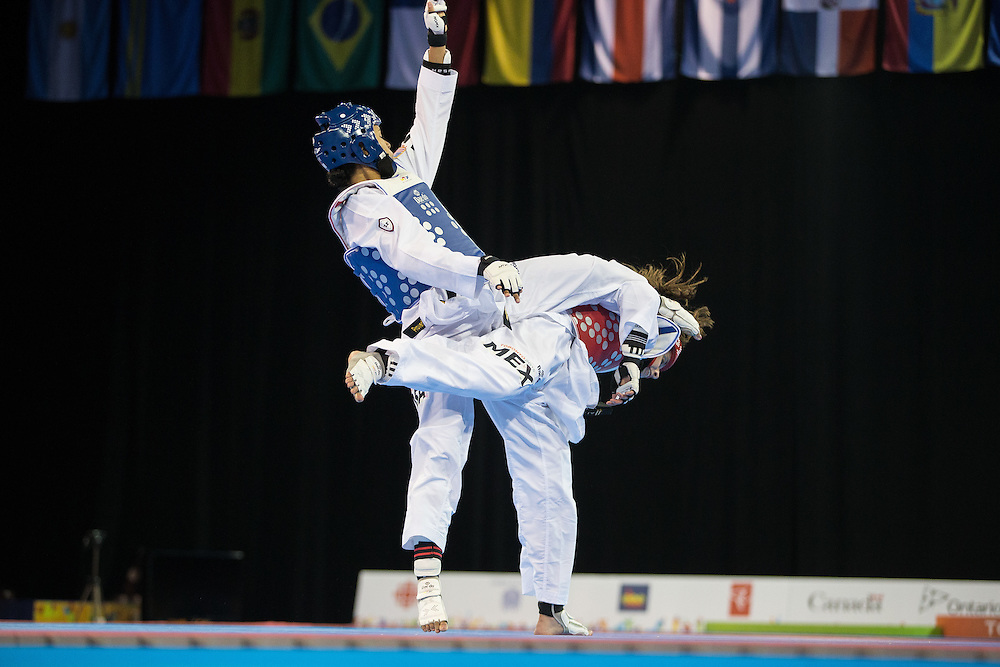 Paige McPherson of the United States kicks Victoria Heredia of Mexico during their gold medal contest in women's taekwondo -67 kg division at the 2015 Pan American Games in Toronto, Canada, July 21,  2015.  AFP PHOTO/GEOFF ROBINS