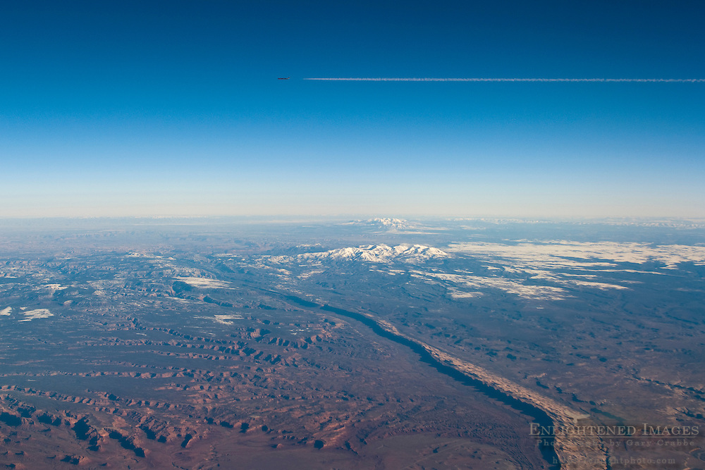 Jet airliner & contrail passing through clear blue sky at high altitude above Capitol Reef NP; Utah