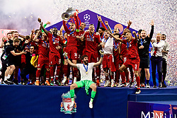 MADRID, SPAIN - SATURDAY, JUNE 1, 2019: Liverpool's captain Jordan Henderson lifts the trophy after the UEFA Champions League Final match between Tottenham Hotspur FC and Liverpool FC at the Estadio Metropolitano. Liverpool won 2-0 to win their sixth European Cup. (Pic by David Rawcliffe/Propaganda)