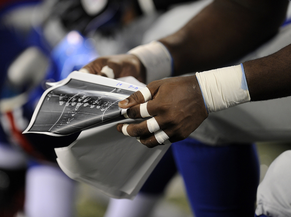 EAST RUTHERFORD, NJ - AUGUST 29: A general view of a football player reviewing the plays on the sidelines during a preseason game between the New York Jets and the New York Giants at Giants Stadium on August 29, 2009 in East Rutherford, New Jersey. The New York Jets beat the New York Giants 27-25. (Photo by Rob Tringali) *** Local Caption ***