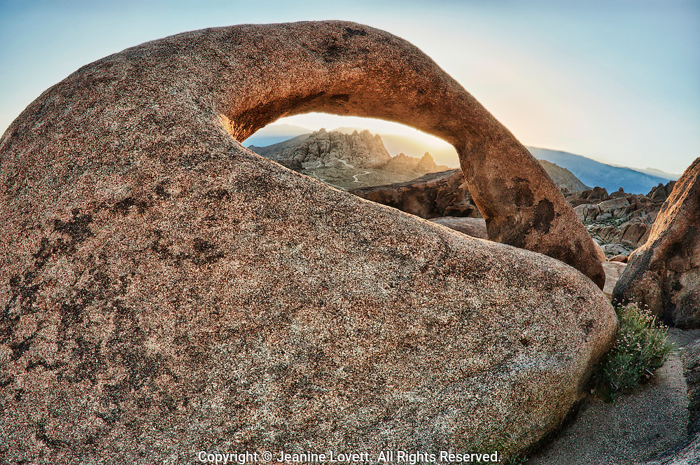 Granite arch giving an opening to Alabama Hills rocks. California, Alabama Hills is were many Hollywood westerns were filmed.