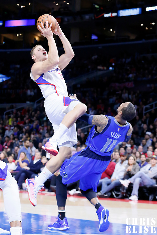 10 January 2014: Los Angeles Clippers forward Blake Griffin (32) goes for the layup over Dallas Mavericks guard Monta Ellis (11) during the Los Angeles Clippers 120-100 victory over the Dallas Mavericks, at the Staples Center, Los Angeles, California, USA.
