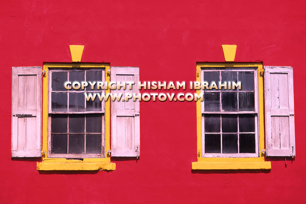 Red House windows with vibrant yellow colors