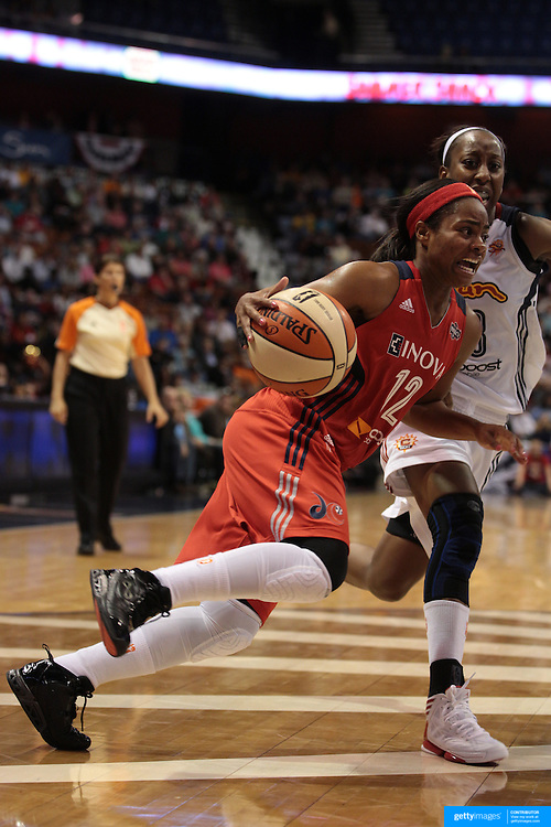 Ivory Latta, Washington Mystics, drives past Allison Hightower, Connecticut Sun, during the Connecticut Sun V Washington Mystics WNBA regular season game at Mohegan Sun Arena, Uncasville, Connecticut, USA. 7th June 2013. Photo Tim Clayton
