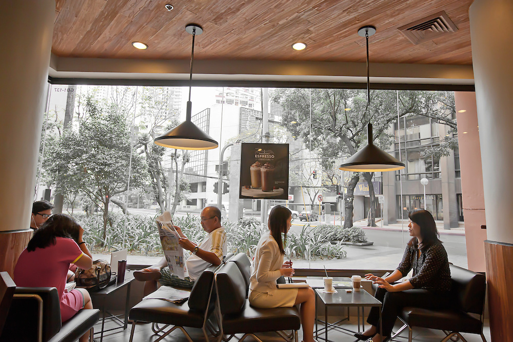 People enjoy their morning at Starbuck's, in Makati district of Manila, Philippines. Copyright 2015 Reid McNally.