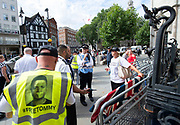 Tommy Robinson AKA Stephen Yaxley Lennon appeal hearing at The High Courts of Justice, London, Great Britain <br /> 18th July 2018 <br /> <br /> Tommy Robinson supporters outside the High Court as the appeal gets underway inside, officials refuse to allow supporters to drape their flags over the court fences. <br /> <br /> Photograph by Elliott Franks