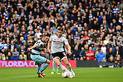 Fulham FC midfielder Tom Cairney (10) takes on Queens Park Rangers forward Conor Washington (9) during the EFL Sky Bet Championship match between Fulham and Queens Park Rangers at Craven Cottage, London, England on 1 October 2016. Photo by Jon Bromley.