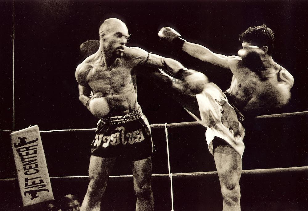 Italian contest Kick-boxing 65 kg. (WAKO). High-kick on the target.