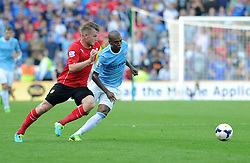 Manchester City's Fernandinho and Cardiff City's Aron Gunnarsson chase down the ball. - Photo mandatory by-line: Alex James/JMP - Tel: Mobile: 07966 386802 25/08/2013 - SPORT - FOOTBALL - Cardiff City Stadium - Cardiff -  Cardiff City V Manchester City - Barclays Premier League