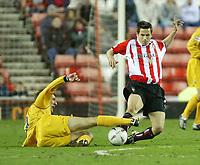 Photo. Andrew Unwin.<br /> Sunderland v Preston North End, Nationwide League Division One, Stadium of Light, Sunderland 11/03/2004.<br /> Preston's Richard Cresswell (l) puts in a sliding challenge on Sunderland's Paul Thirlwell (r).