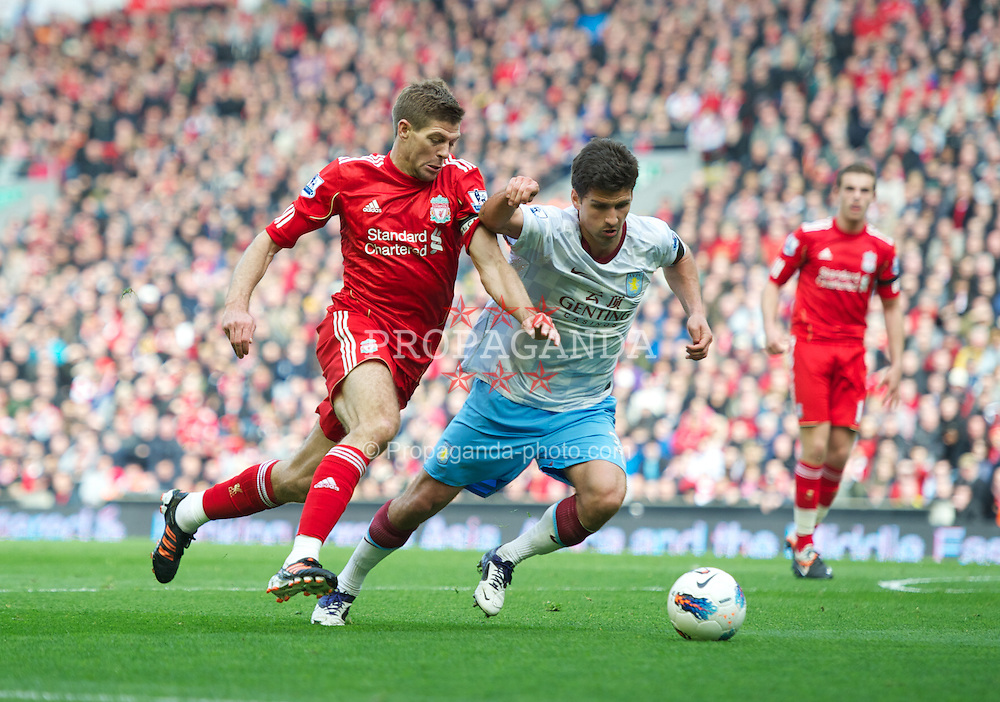 LIVERPOOL, ENGLAND - Saturday, April 7, 2012: Liverpool's captain Steven Gerrard in action against Aston Villa's Eric Lichaj during the Premiership match at Anfield. (Pic by David Rawcliffe/Propaganda)