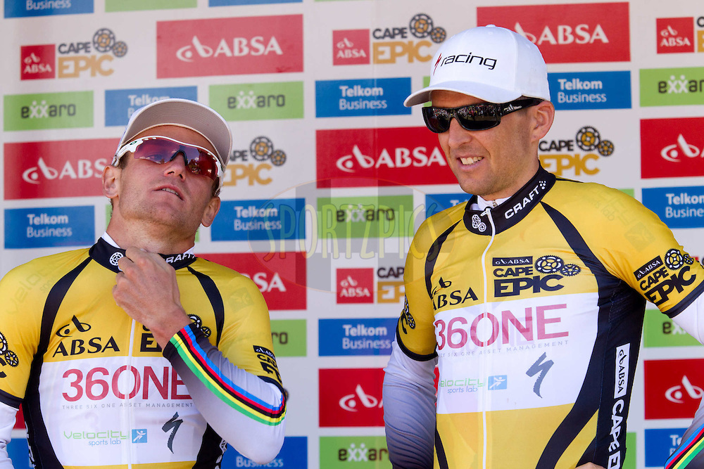 Christoph Sauser and Burry Stander accustomed to zipping up the yellow jersey after 5 out of 7 stage wins after stage 6 of the 2012 Absa Cape Epic Mountain Bike stage race held in and around Oak Valley Wine Estate in the Elgin Valley, South Africa on the 31 March 2012..Photo by Greg Beadle/Cape Epic/SPORTZPICS