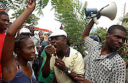 Port-au-Prince, Haiti.<br />Irate investors protest the collapse of a banking pyramid scheme outside government offices. Haiti is the western hemisphere's poorest country.