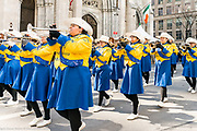 The Cathedral High School band marching in front of St. Patrick's Cathedral during the St. Patrick's Day Parade in New York City