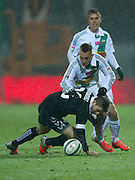(L) Polonia's Aleksandar Todorovski and (R) Lechia's Pawel Buzala fight for the ball during T-Mobile Extraleague soccer match between Polonia Warsaw and Lechia Gdansk in Warsaw, Poland...Poland, Warsaw, February 22, 2013...Picture also available in RAW (NEF) or TIFF format on special request...For editorial use only. Any commercial or promotional use requires permission...Photo by © Adam Nurkiewicz / Mediasport