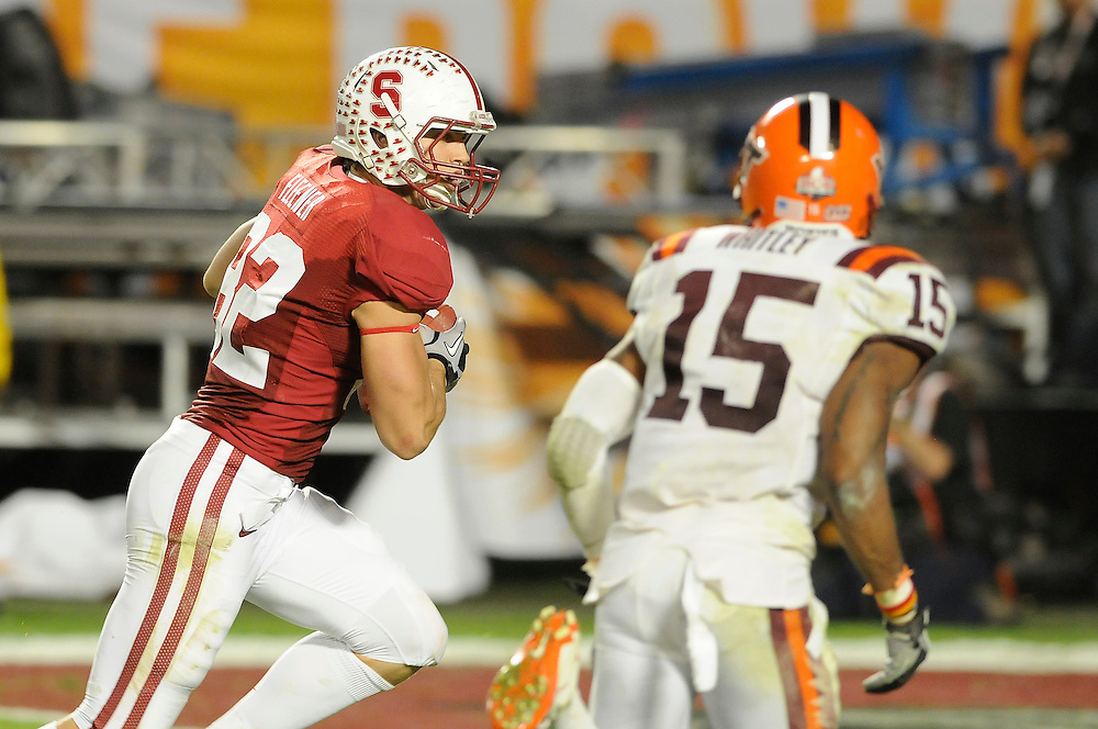 January 3, 2011: Coby Fleener of the Stanford Cardinal runs past Eddie Whitley of the Virginia Tech Hokies for a touchdown during the NCAA football game between the Stanford Cardinal and the Virginia Tech Hokies at the 2011 Orange Bowl in Miami Gardens, Florida. Stanford defeated Virginia Tech 40-12.