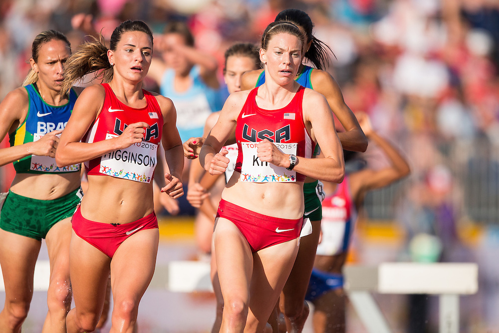 Ashley Higginson (L) and teammate Shalaya Kipp of the United States lead the pack over the water barrier during the women's steeplechase at the 2015 Pan American Games at CIBC Athletics Stadium in Toronto, Canada, July 24,  2015.  AFP PHOTO/GEOFF ROBINS