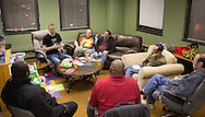 Nick Rhoades (second on left) talks during a PITCH meeting in Waterloo, Iowa on Thursday, November 7, 2013. PITCH, which stands for Positive Iowans Taking Charge, is a group of HIV+ people who meet together. Seven people attended the meeting.