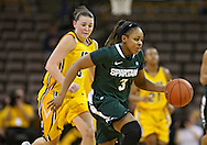 January 27 2010: Michigan St. guard Porsche Poole (3) drives by Iowa forward Kalli Hansen (3) during the second half of an NCAA women's college basketball game at Carver-Hawkeye Arena in Iowa City, Iowa on January 27, 2010. Iowa defeated Michigan State 66-64.