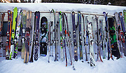 SHOT 3/12/10 9:41:07 AM - Skis and snowboards lined up and ready to go to work at Silverton Mountain in Silverton, Co. Silverton Mountain is unique amongst ski resorts requiring a guide (most of the season), avalanche gear and limiting the number of daily visitors. There are multiple bowls, chutes, cliffs and natural terrain features to be discovered during a visit to Silverton Mountain. It is the highest Ski Area in North America with a peak of 13,487' and it is also the steepest with no easy way down. The mountain is left in it's natural state with the exception of the avalanche reduction work which occurs. There is only one chair at the mountain though most skiiers and snowboarders will end up hiking in various directions at the top. The mountain also features heliskiing trips for $159 a trip (at the time of visit). The mountain opened in 2002. (Photo by Marc Piscotty / © 2010)