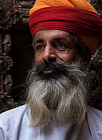 JODHPUR, INDIA - CIRCA NOVEMBER 2018: Portrait of guard at the Mehrangarh Fort in Jodhpur. The fort is one of the largest forts in India. Built in around 1459 by Rao Jodha, the fort is situated above the city and is enclosed by imposing thick walls. Jodhpur is the second largest city in the Indian state of Rajasthan. Jodhpur is a popular tourist destination, featuring many palaces, forts and temples, set in the stark landscape of the Thar Desert. It is popularly known as Blue city and Sun city among people of Rajasthan and all over India