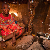 A Samburu woman with sad eyes in her home in northern Kenya