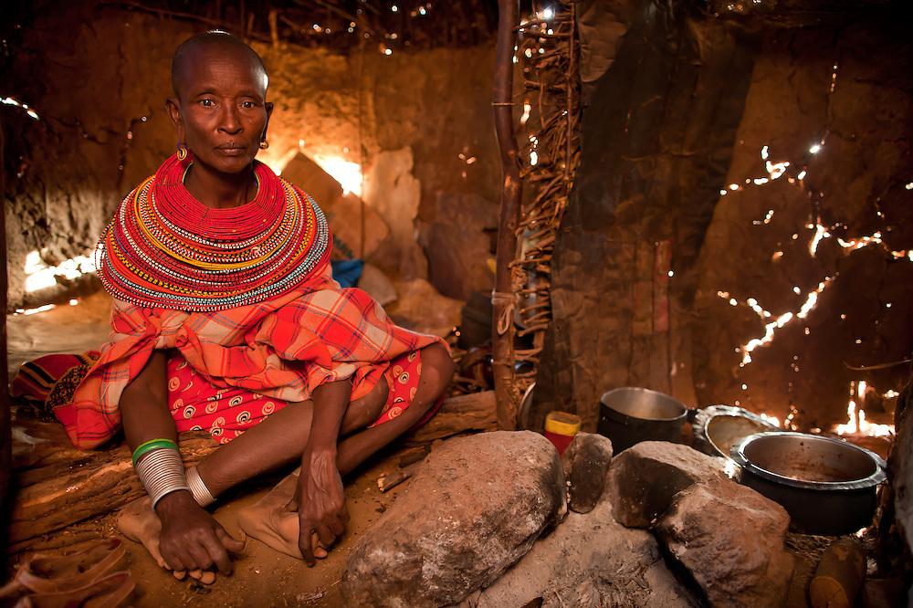 A Samburu woman with sad eyes in her home in northern Kenya
