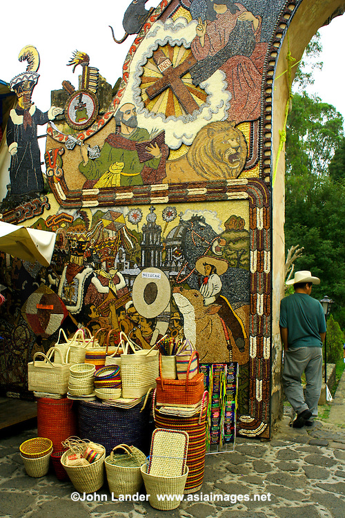 On Sundays the market place in Tepoztlan is a bedlam of colours, smells, people, free roaming donkeys and local products. The arch is made up of various kinds of seeds.