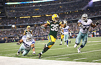 Green Bay Packers cornerback Tramon Williams (38) runs with the ball after an interception during the Green Bay Packers against the Dallas Cowboys  NFL game in Dallas, Texas Sunday, December, 15, 2013. (AP Photo/Tom Hauck)