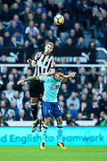 Florian Lejeune (#20) of Newcastle United wins a header against Callum Wilson (#13) of AFC Bournemouth during the Premier League match between Newcastle United and Bournemouth at St. James's Park, Newcastle, England on 4 November 2017. Photo by Craig Doyle.