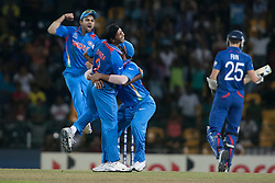 © Licensed to London News Pictures. 23/09/2012. Indian bowler Ashok Dinda celebrates with his teammates after getting the wicket of Stuart Broad during the T20 Cricket World T20 match between England Vs India at the R.Premadasa Cricket Stadium,Colombo. Photo credit : Asanka Brendon Ratnayake/LNP