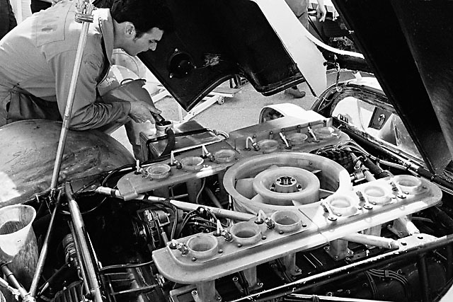 Porsche mechanic pours some Gulf oil into JW Automotive Porsche 917 at 1970 Daytona 24 Hour race; photo by Pete Lyons