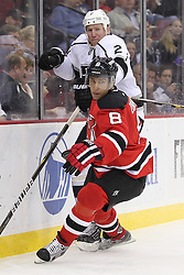 Oct 13; Newark, NJ, USA; Los Angeles Kings defenseman Matt Greene (2) is hit by New Jersey Devils right wing Dainius Zubrus (8) during the second period at the Prudential Center.