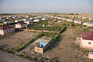 A recently-built camp for internally displaced people from Nagorno-Karabakh, in the Agdam region of Azerbaijan.  The Azerbaijani government is using some of the revenue from new oil production to construct better housing for IDPs, but people still lack viable employment opportunities in the camps.