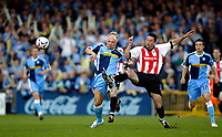 Photo: Marc Atkins.<br /> <br /> Wycombe Wanderers v Cheltenham Town. Coca Cola League 2, Play off Semi Final. 13/05/2006. Tommy Mooney of Wycombe <br /> <br /> (L) battles for the ball.