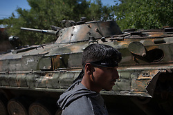 Syria<br /> A rebel soldier from the FSA stands up besides  of a BMP-1 tank taken by the Free Syrian Army parked in an area close to the M4 where different factions of rebels and regime forces have been fighting for the last weeks.<br /> Rebels and activists have been reporting heavy clashes between rebels and government forces in Idlib province as government troops are trying to take control of the highway that leads to the neighbouring Latakia province, Idlib<br /> Syria<br /> Saturday, 22nd June 2013<br /> Picture by Daniel Leal-Olivas / i-Images