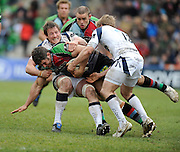 Twickenham, GREAT BRITAIN,  Quins',  Nick EASTER, caught by Sharks Dean SCHOFIELD and Matt TAIT, during the Guinness Premiership match, Harlequins vs Sale Sharks, played at Twickenham Stoop, Twickenham, Surrey, on Saturday  08/05/2010  [Photo Peter Spurrier/Intersport-images]