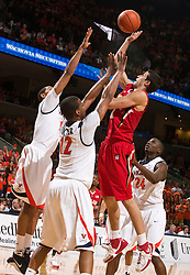 Maryland guard Greivis Vasquez (21) is defended by Virginia forward Jamil Tucker (12).  The Virginia Cavaliers defeated the Maryland Terrapins 68-63 at the John Paul Jones Arena on the Grounds of the University of Virginia in Charlottesville, VA on March 7, 2009.