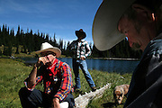 """This is my way of being able to experience the backcountry,"" Ray Ewing,  right, said while relaxing with his buddies Kenny Schulz, left, and Russ Sieck, center, Friday, August 24, 2007. The group of retired men who go by ""The Over the Hill Gang,"" rode 20-miles on horseback to eat lunch at an alpine lake several thousands feet up in the high country near Mount Rainier in Washington State. ."