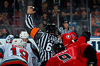 KELOWNA, BC - DECEMBER 30: Referee Mike Langin indicates the puck drop at centre ice between Kelowna Rockets and Prince George Cougars at Prospera Place on December 30, 2019 in Kelowna, Canada. (Photo by Marissa Baecker/Shoot the Breeze)