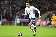 Dele Alli of Tottenham Hotspur (20) dribbling during the Premier League match between Tottenham Hotspur and Brighton and Hove Albion at Wembley Stadium, London, England on 13 December 2017. Photo by Matthew Redman.