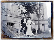 happy smiling couple on stairs in front of their house 1910s 1920s