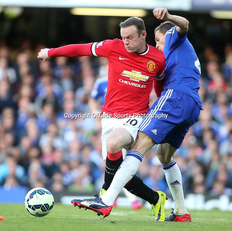 18 April 2015 - Barclays Premier League - Chelsea v Manchester United - Wayne Rooney of United is tackled by Nemanja Matic of Chelsea.<br /> <br /> <br /> Photo: Ryan Smyth/Offside