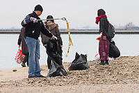 "The Jackson Park Advisory Council celebrated Earth Day Saturday afternoon, April 21st, 2018 with a clean up of 57th Street Beach. Volunteers from all over the city came to help.<br /> <br /> 7346, 7340 – Al Debonnett and other volunteers pick up garbage off the beach.<br /> <br /> Please 'Like' ""Spencer Bibbs Photography"" on Facebook.<br /> <br /> Please leave a review for Spencer Bibbs Photography on Yelp.<br /> <br /> Please check me out on Twitter under Spencer Bibbs Photography.<br /> <br /> All rights to this photo are owned by Spencer Bibbs of Spencer Bibbs Photography and may only be used in any way shape or form, whole or in part with written permission by the owner of the photo, Spencer Bibbs.<br /> <br /> For all of your photography needs, please contact Spencer Bibbs at 773-895-4744. I can also be reached in the following ways:<br /> <br /> Website – www.spbdigitalconcepts.photoshelter.com<br /> <br /> Text - Text ""Spencer Bibbs"" to 72727<br /> <br /> Email – spencerbibbsphotography@yahoo.com"